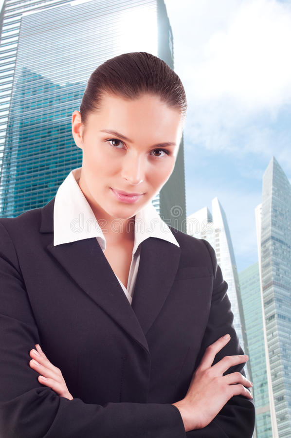 Business woman over business center background stock images