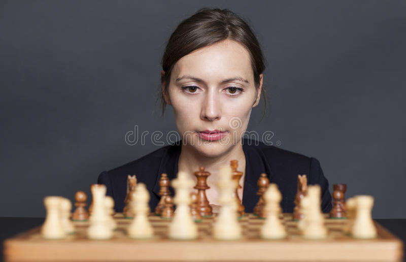 Download Business Woman Over A Chess Game Stock Image - Image: 23817597
