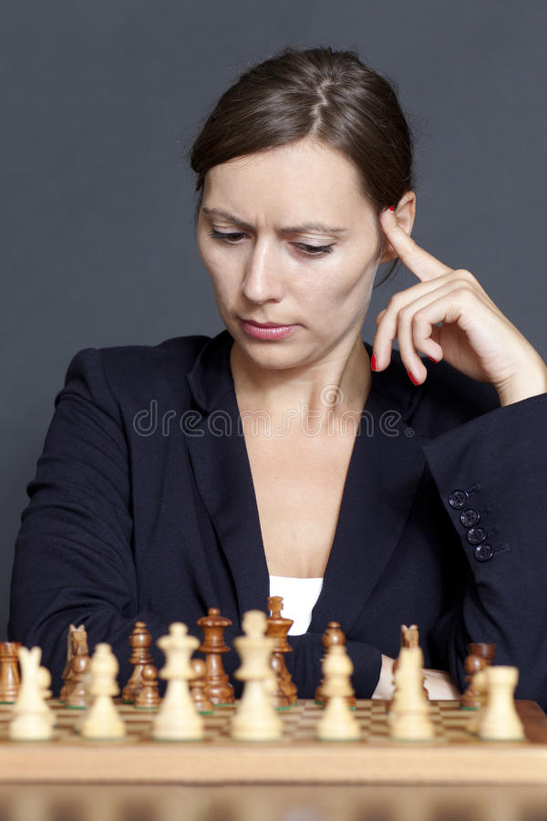 Download Business Woman Over A Chess Game Stock Photo - Image: 23817620
