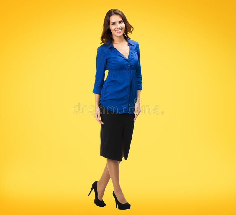 Business woman, over yellow orange background stock images