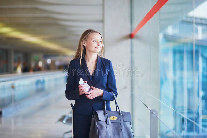 Business woman with passport and boarding pass in international airport stock images