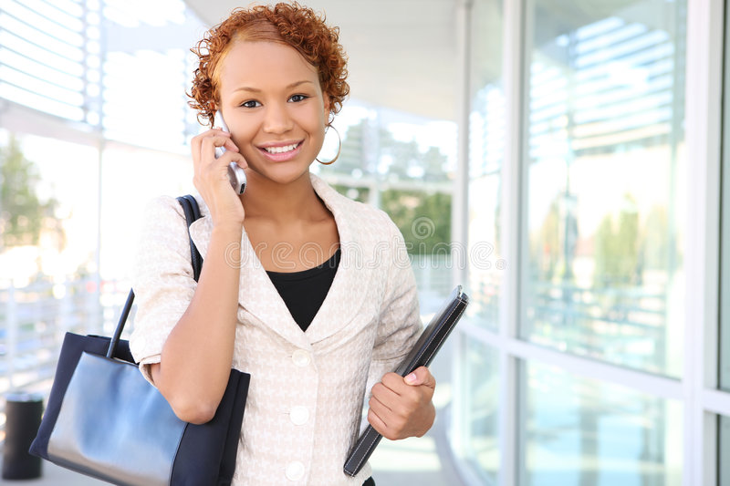 Business Woman on Phone at Office