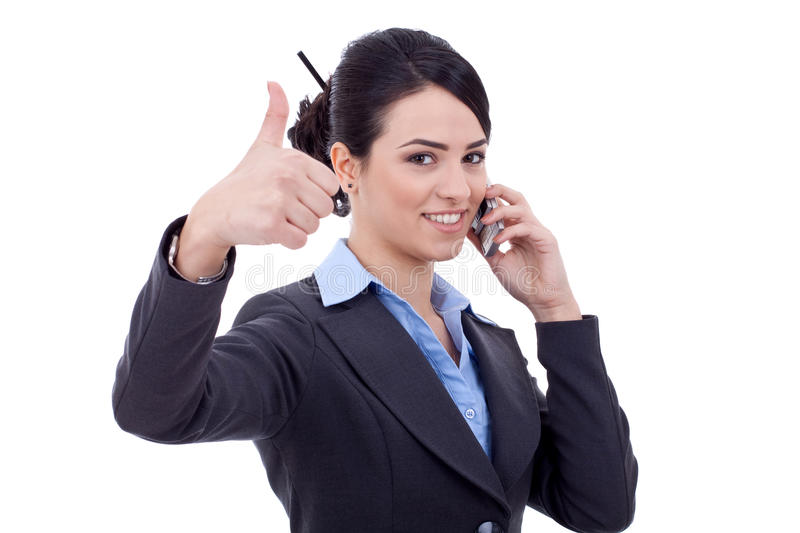 Business woman with phone and thumbs up. Happy business woman with phone and thumbs up gesture, isolated royalty free stock images