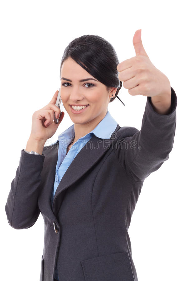 Business woman with phone and thumbs up gesture. Happy business woman with phone and thumbs up gesture, isolated royalty free stock images