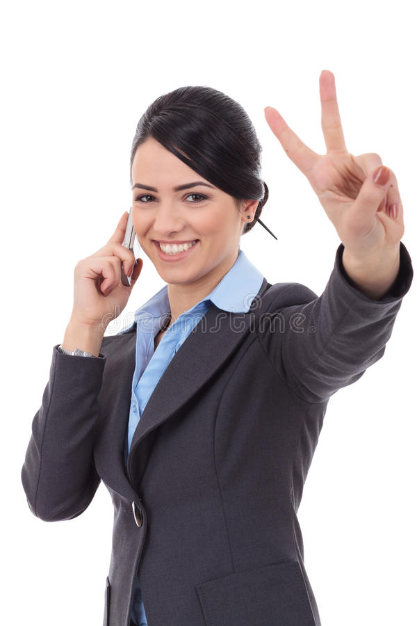 Business woman with phone and victory gesture. Happy business woman with phone and victory gesture, isolated royalty free stock images
