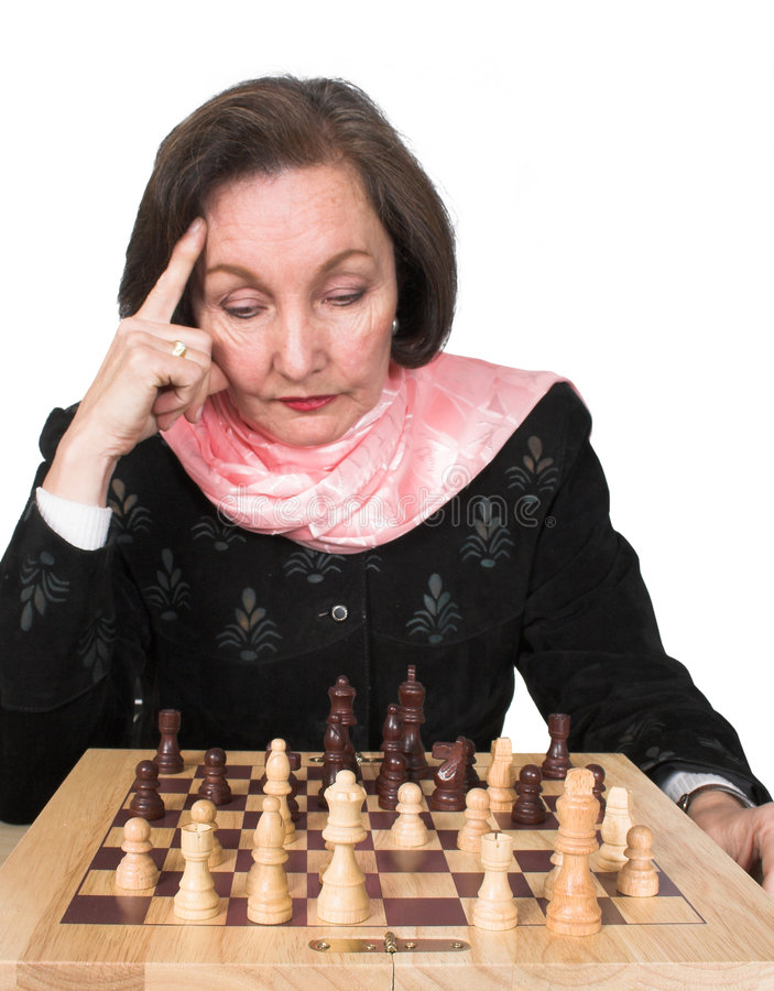 Business woman planning her next move - chess