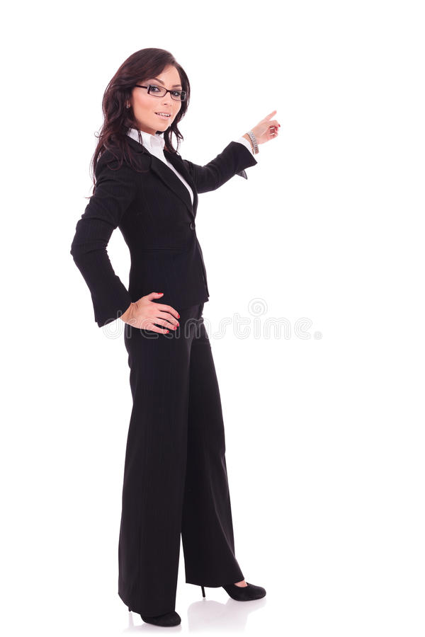 Business woman pointing away stock photography