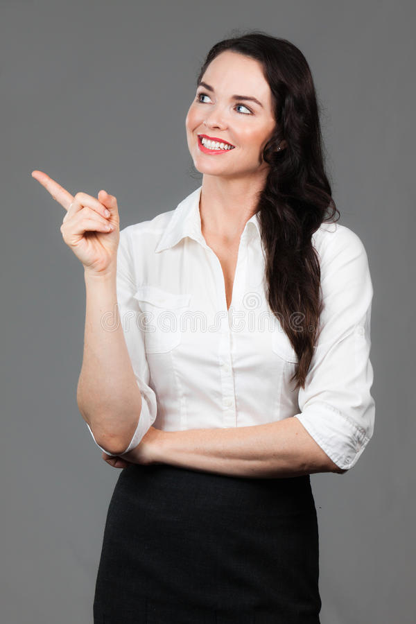 Download Business Woman Pointing At Copyspace Stock Image - Image: 24098315