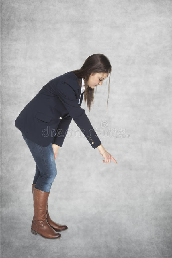 Business woman pointing finger royalty free stock photo