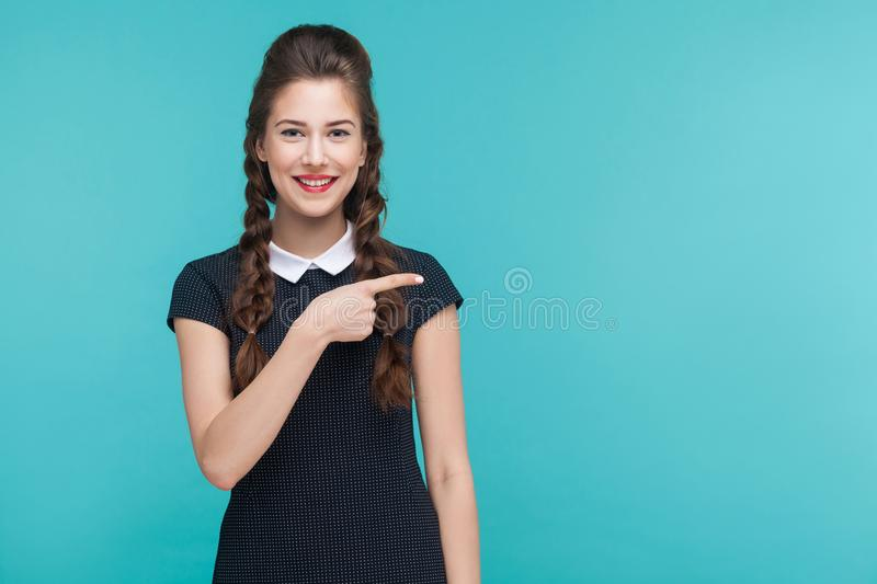 Business woman pointing finger right, at copy space. stock image