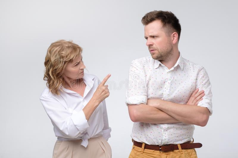 Business woman pointing at her coworker blaming him stock image