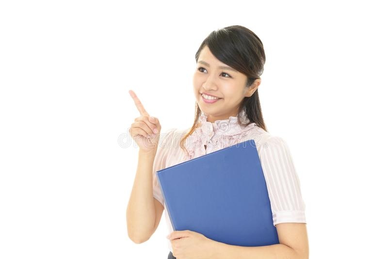 Smiling business woman. Business woman pointing with her finger royalty free stock image