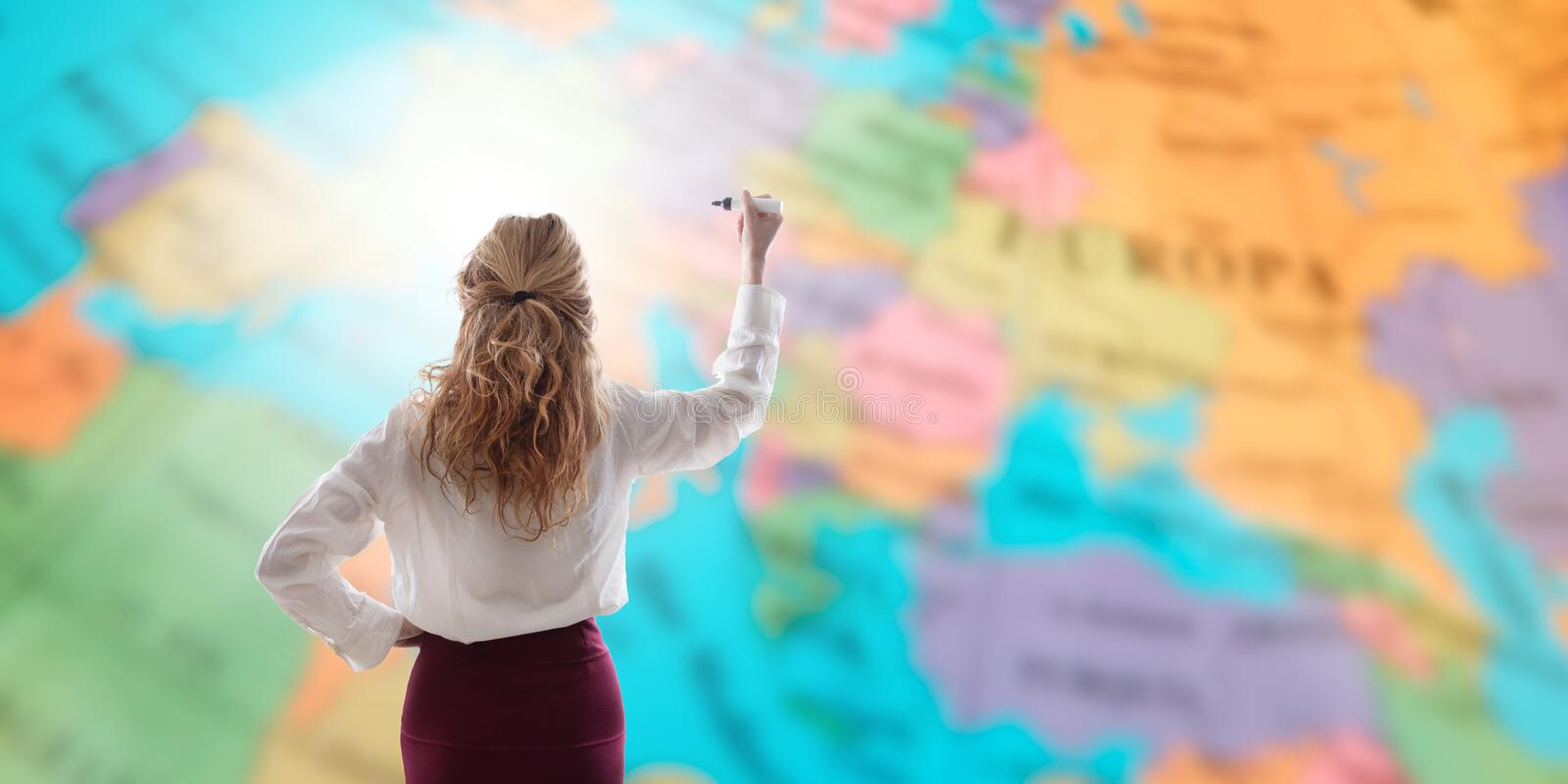 Business woman pointing on the map stock photos