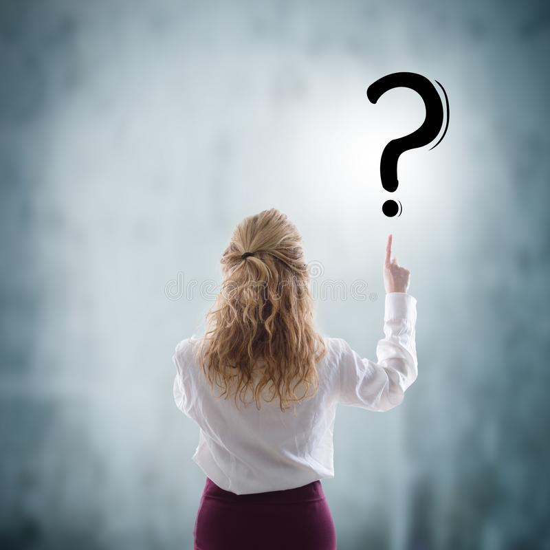 Business woman pointing out the questioning stock image