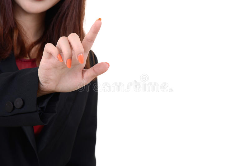 Business woman pointing something. Business woman in black suit use her finger point to something on white background stock image