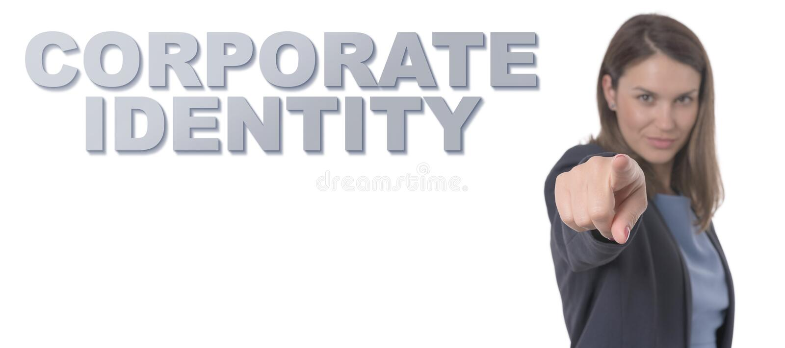 Business Woman pointing the text CORPORATE IDENTITY stock photography
