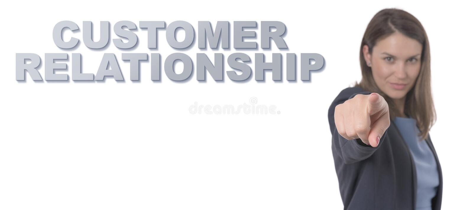 Business Woman pointing the text CUSTOMER RELATIONSHIP royalty free stock photo