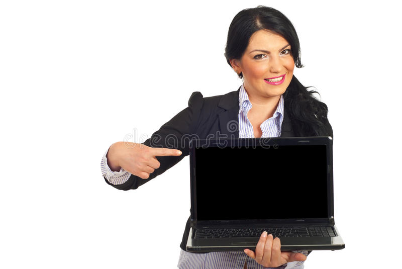 Business woman pointing to laptop screen. Happy business woman pointing to blank laptop screen isolated on white background stock image