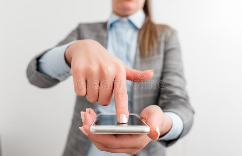 Business woman points with finger on touch screen. Business concept with finger on the mobile touch screen. Business woman points with finger on touch screen royalty free stock photos