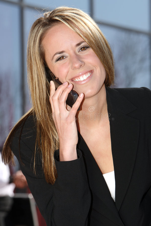 Business Woman Portrait with phone. Good looking Caucasian business woman talking on the phone royalty free stock photos