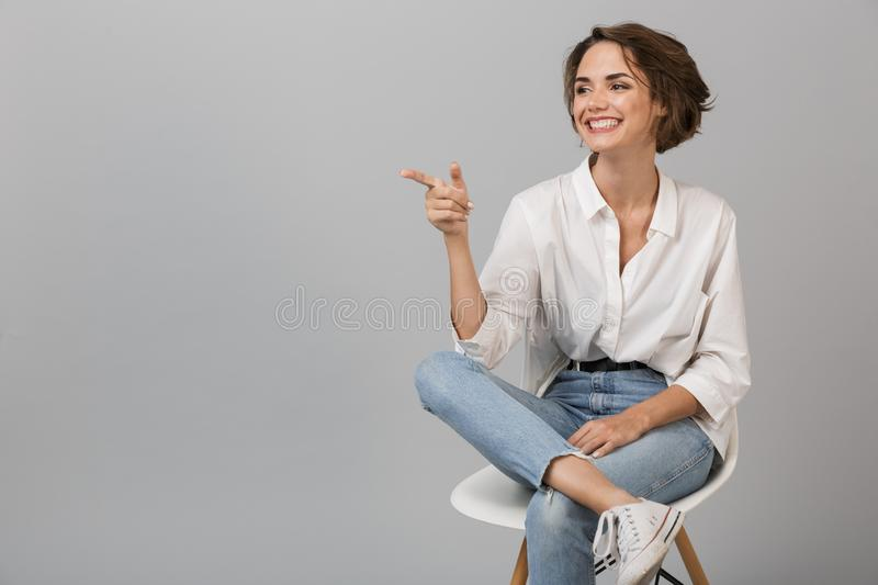 Business woman posing isolated over grey wall stock photography