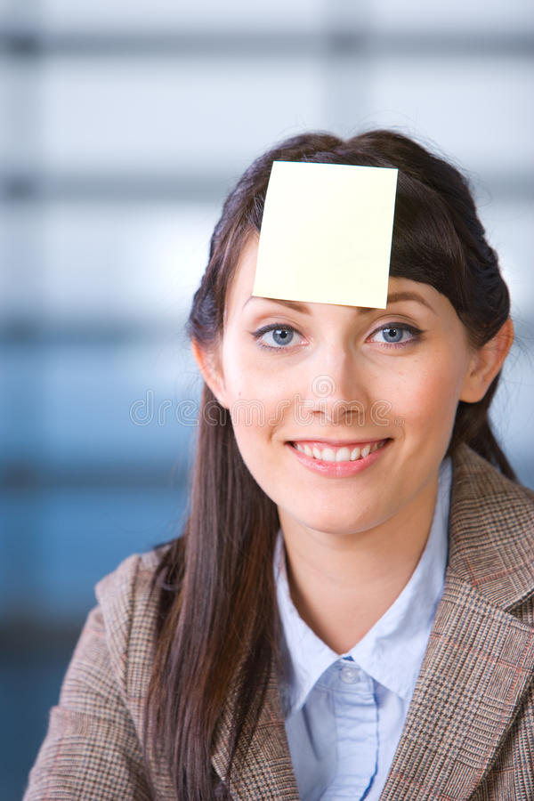 Business Woman post it on head royalty free stock image