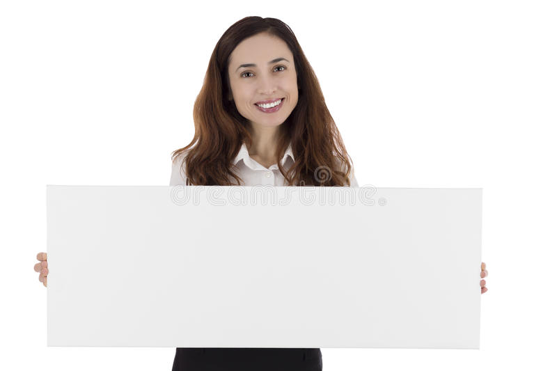 Business woman presenting a blank advertisement poster. Business woman in formal dress smiling and presenting a blank white poster for texts and advertisements royalty free stock photography
