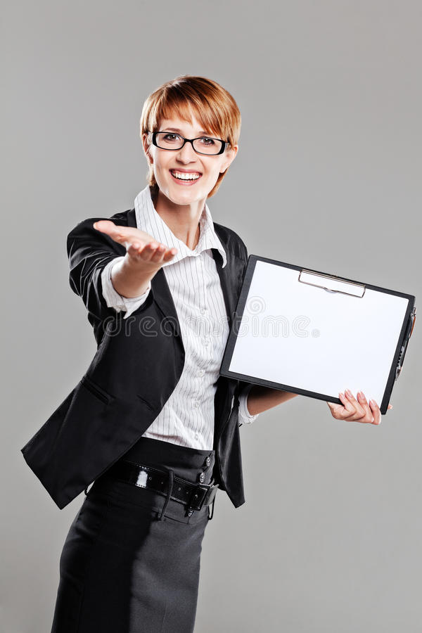 Business woman presenting a clipboard stock photos