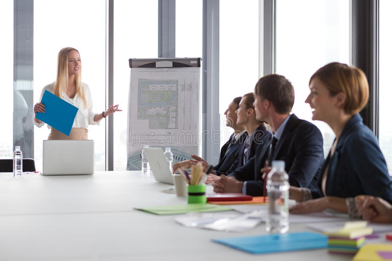Business woman presenting project to her colleagues royalty free stock photos