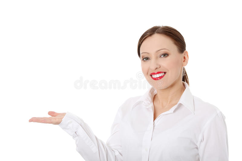 Download Business Woman Presenting Something On Her Hand. Royalty Free Stock Images - Image: 19037079