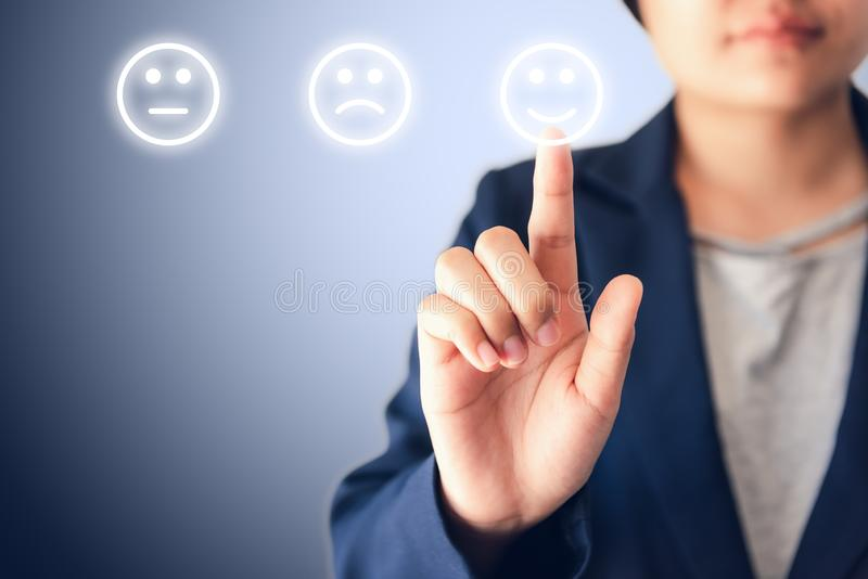 Business Woman Pressing Satisfaction Icon for Customer Feedback on Touch Screen., Media Survey or Poll Questionnaire, Efficiency P royalty free stock photography