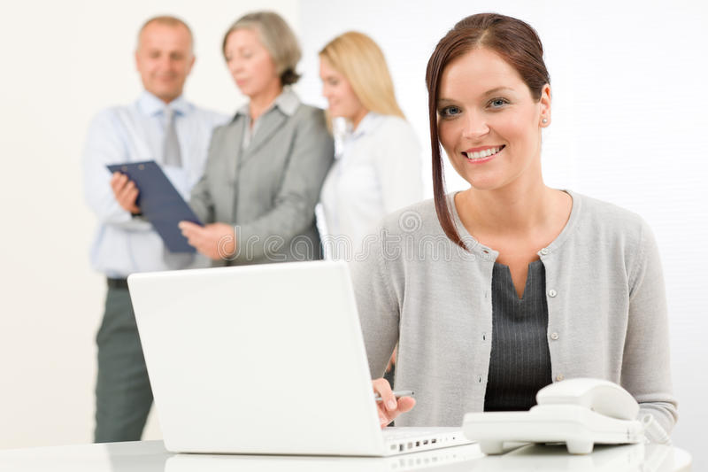 Download Business Woman Pretty With Colleagues Discussing Stock Image - Image: 23164469