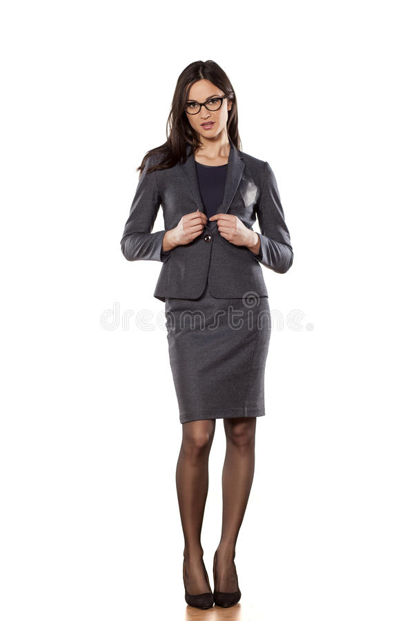 Business woman. Pretty business woman with eyeglasses standing on white background stock photos