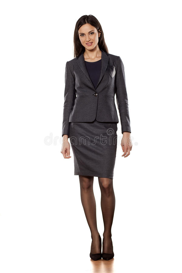 Business woman. Pretty business woman standing on white background royalty free stock image
