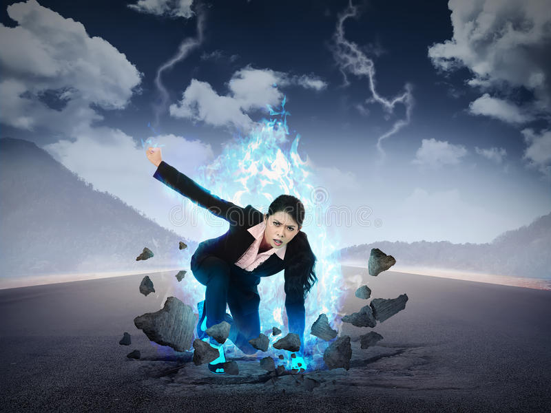 Business woman punch the road with blue fire power. Business power conceptual royalty free stock image