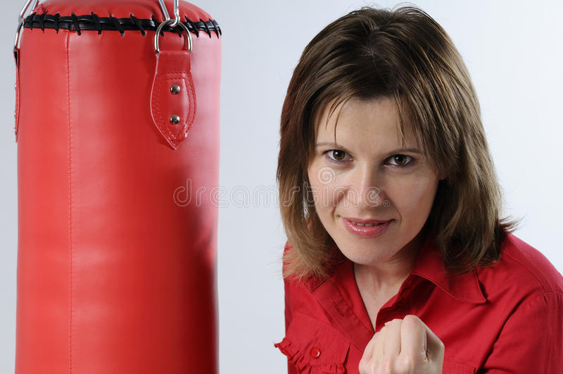 Business Woman And Punching Bag Stock Photo