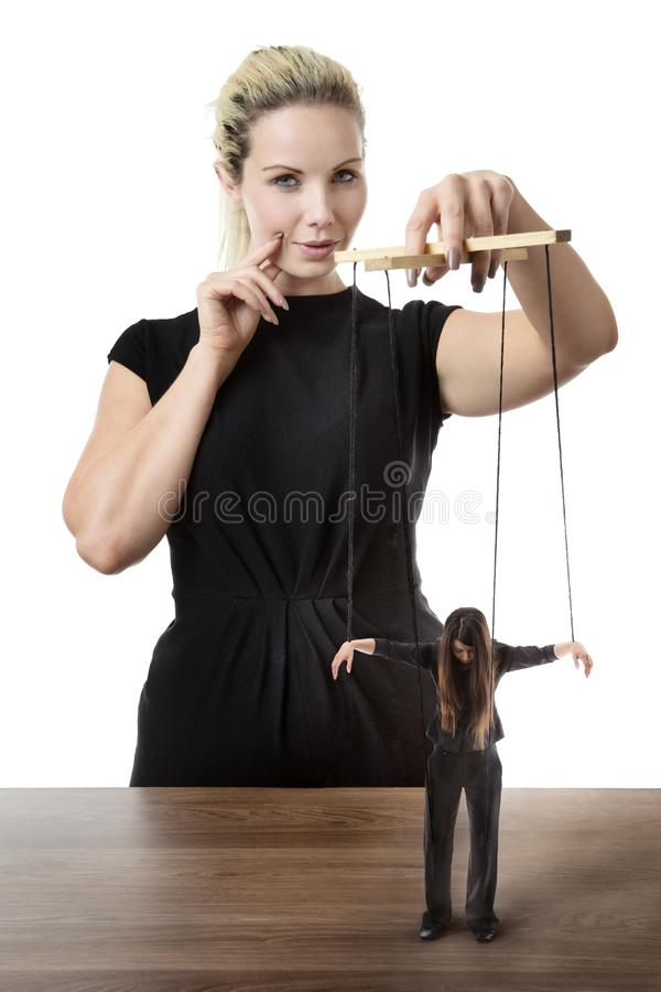 Business woman puppet master stock photos