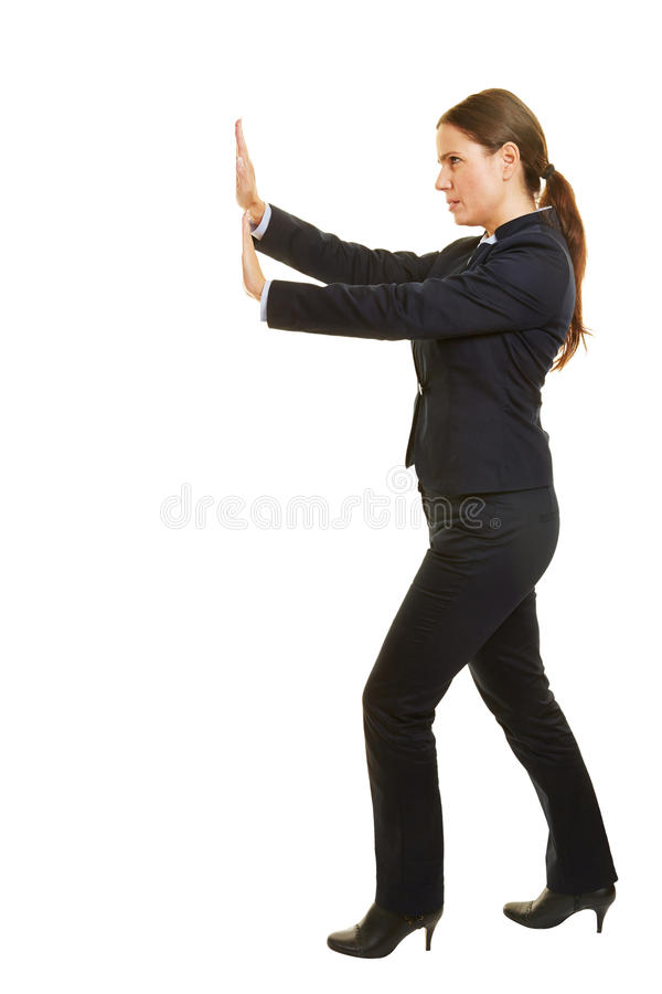 Business woman pushing boundary to the side stock photo