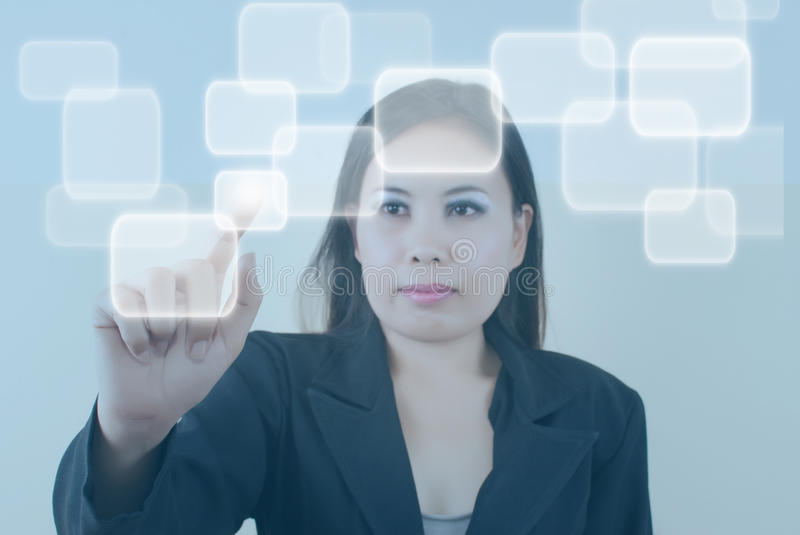 Business woman pushing button on the whiteboard. This image for business concept with business lady stock images