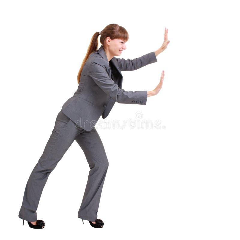 Download Business Woman Pushing Something Stock Photo - Image: 10869570