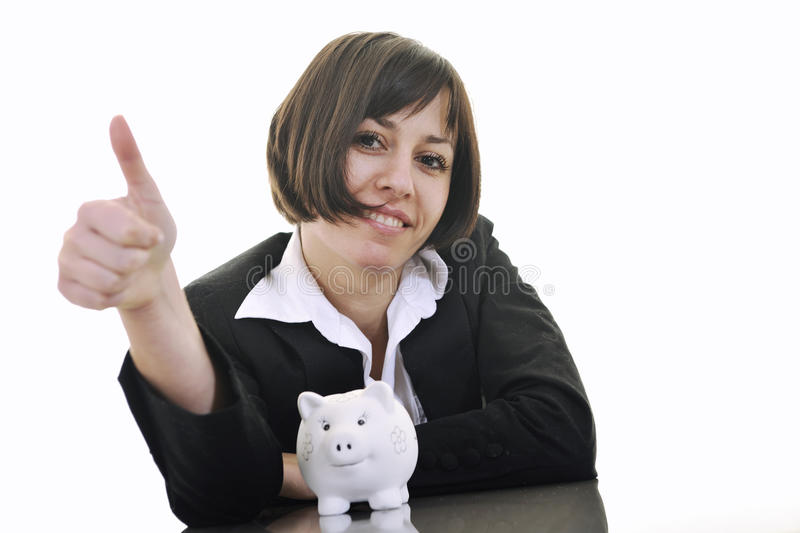 Business woman putting coins money in piggy bank. Happy young business woman isolated on white puting euro money in piggy bank stock photography