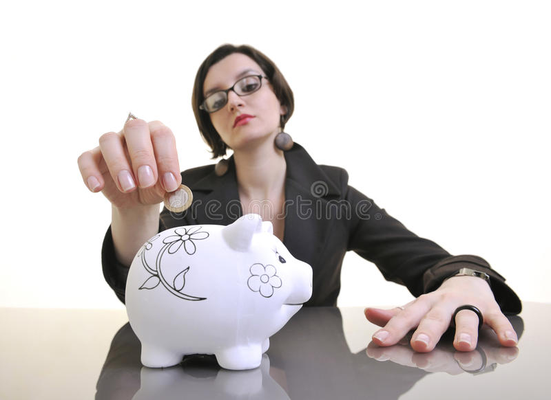 Download Business Woman Putting Money Coins In Piggy Bank Royalty Free Stock Photo - Image: 13632545