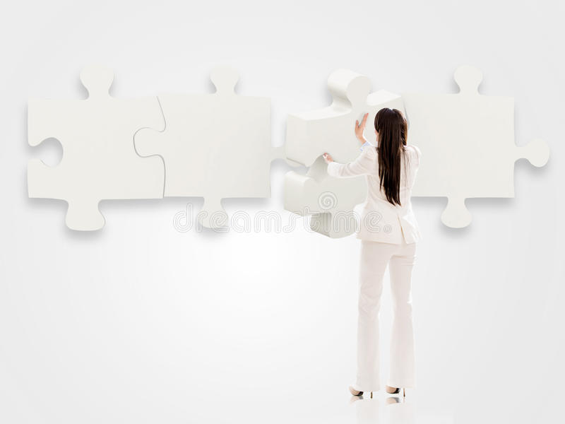 Download Business Woman With A Puzzle Stock Photo - Image: 30556142