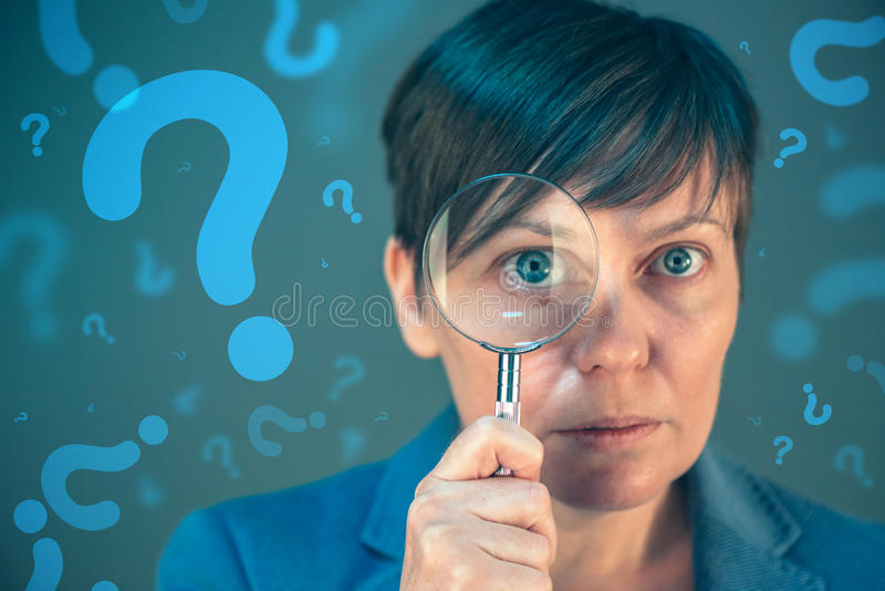 Business woman with question marks looking for answers royalty free stock photography
