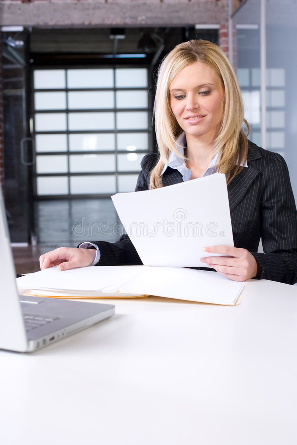 Free Business Woman Reading Documents Stock Photos - 8524593
