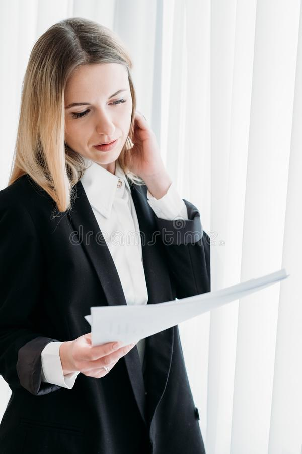 Business woman read document office executive work. Business woman reading documents in his office. stylish young beautiful executive at work royalty free stock photos
