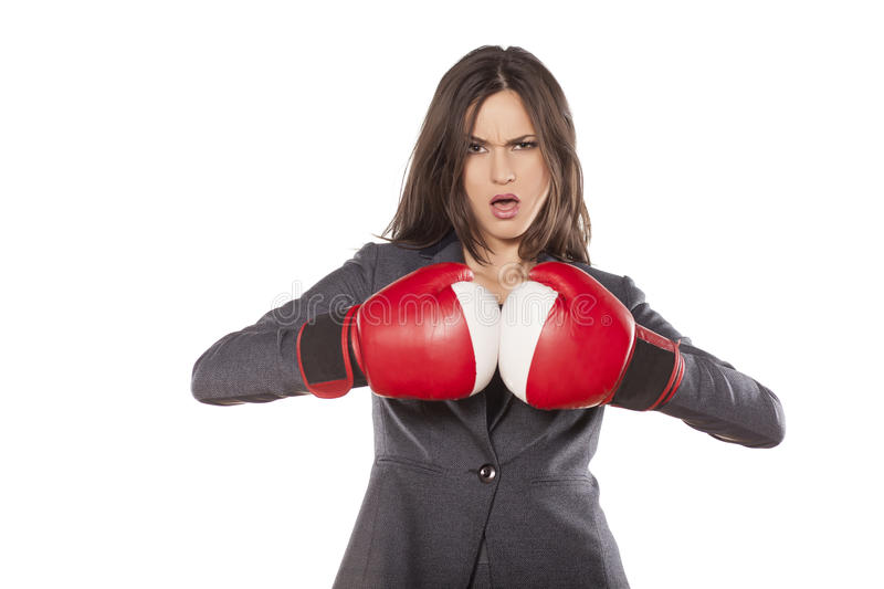 Business woman ready to fight. Angry business woman with boxing gloves on white background stock photos