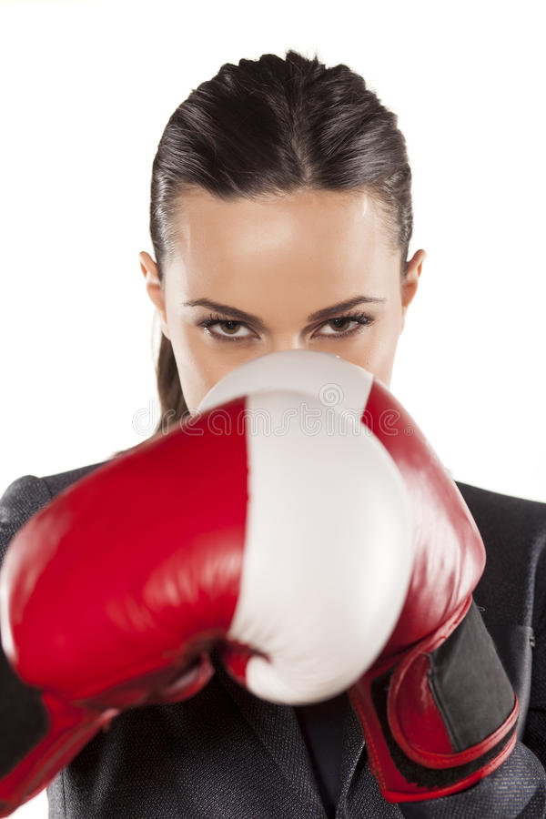 Business woman ready to fight. Angry business woman with boxing gloves on white background stock photo