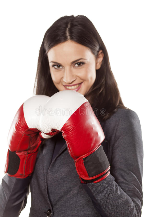 Business woman ready to fight. Happy business woman with boxing gloves on white background stock photo