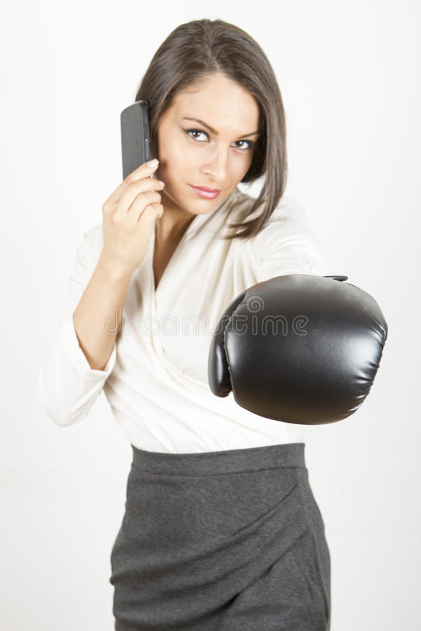 Competitive business woman ready to fight royalty free stock image
